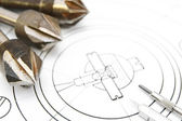 Drills and compasses on the drawing. — Stock Photo