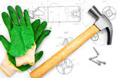 Hammer, screws, gloves and the drawing. — Stock Photo