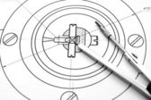 Compasses and the drawing. — Stock Photo