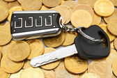 Coins and a key from the car. — Stock Photo
