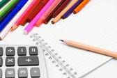 Notebook, pencils, the calculator. — Stock Photo