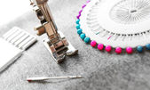 The sewing machine and needles on a fabric. — Stock Photo