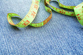 Measuring tape on a fabric (jeans). — Stock Photo