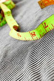To measure on a fabric. — Stock Photo
