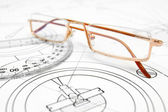 Glasses on the drawing. — Stock Photo