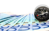 Money and compass. On a white background. — Stock Photo