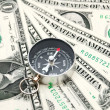 Stock Photo: Compass and money.