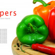 Pepper and spices on a wooden board. — Stock Photo #10910091
