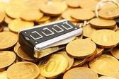 Charm from car on gold coins. — Stock Photo