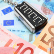 Charm from car on money. — Stock Photo