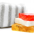 Sponge and multi-coloured soap. - Stock Photo