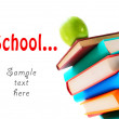 Stock Photo: Books and green apple. On white background.