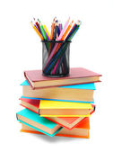 Multi-coloured books and basket with pencils. — Stock Photo