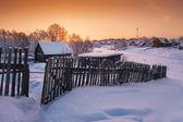 Village under snow at dawn — Stock Photo