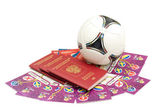 Soccer ball, russian passports and tickets for the European Football Championship 2012. May, 13 2012. The first tickets for Euro 2012 delivered to Russia, Moscow — Stock Photo
