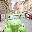 Green retro car on street of Lviv, Ukraine — Stock Photo