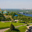 View of church in monastery Lavra, river Dnieper and modern area in Kiev, Ukraine — Stock Photo #11401530