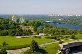 View of church in monastery Lavra, river Dnieper and modern area in Kiev, Ukraine — Stock Photo