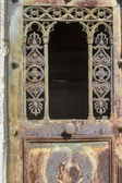 Rusty old iron door with ornamentation — Stock Photo