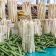 Fresh asparagus on a market stand — Stock Photo
