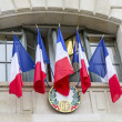 French flags with RF logo hanging on government building wall — Foto Stock