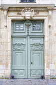Historic wooden door, seen in Paris, France — Stock Photo
