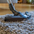 Stock Photo: Vacuum cleaner to tidy up living room