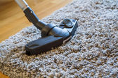 Vacuum cleaner to tidy up the living room — Foto Stock