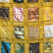 Handmade patchwork quilt from India - Stock Photo