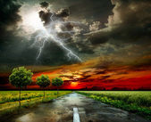 Asphalt road and lightning — Stock Photo