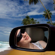 The girl in the car on the beach — Stock Photo
