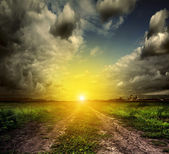 Country road and sunset — Stock Photo