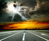 Road and lightning — Stock Photo
