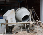 Industrial cement mixer machinery at construction site — Stock Photo