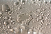 Water droplets on metal surfaces. — Stockfoto