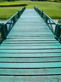 Green wooden bridge — Stock Photo