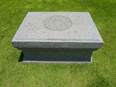 Stone table on grassland — Stock Photo