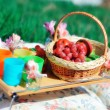 Basket with fruit and flowers — Stock Photo
