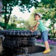 The boy at a fountain - Stock Photo