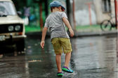 Child in the rain — Stock Photo