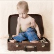 Child and suitcase — Stock Photo