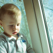 The child at a window — Stock Photo
