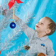Child and New Year tree — Stock Photo