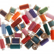 Background bobbins of thread - Stock Photo