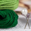 Embroidery floss and pins - Stock Photo