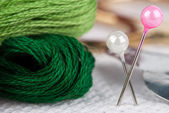 Embroidery floss and pins — Stock Photo
