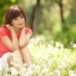 Cute woman in the park with dandelions - Lizenzfreies Foto