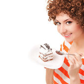 Fun woman eating the cake on the white background — Stock Photo