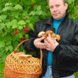 A man with mushrooms — Stock Photo