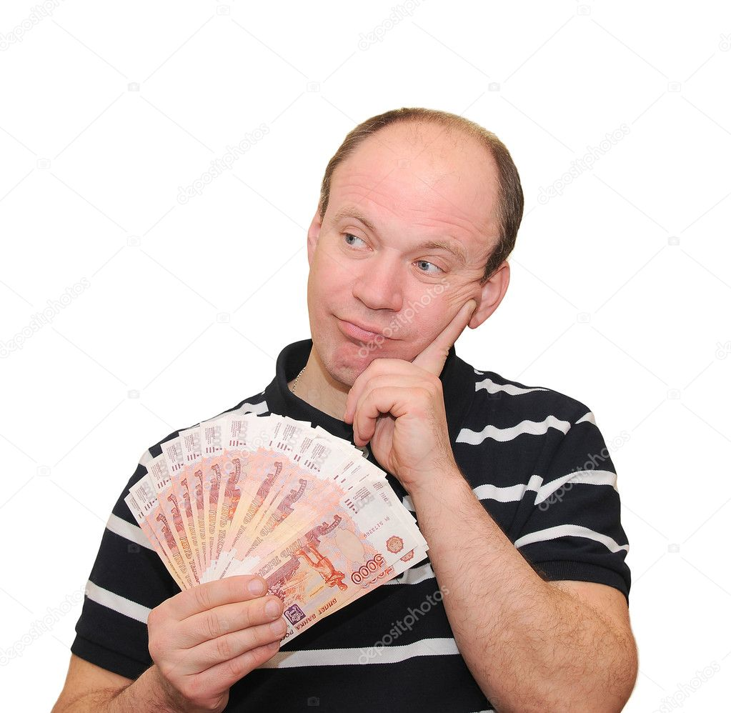 A man holding money is a fan. — Stock Photo #11447176